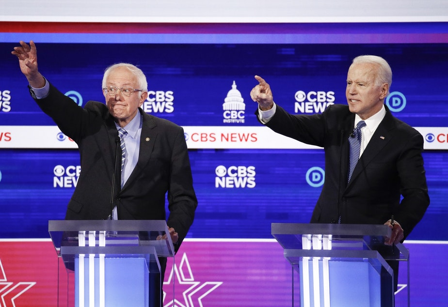 caption: Democratic presidential candidates, Sen. Bernie Sanders, I-Vt., left, and former Vice President Joe Biden, right, participate in a Democratic presidential primary debate at the Gaillard Center, Tuesday, Feb. 25, 2020, in Charleston, S.C., co-hosted by CBS News and the Congressional Black Caucus Institute.
