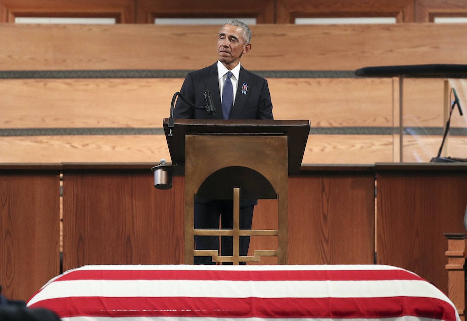 caption: Former President Barack Obama gives the eulogy at the funeral service for Rep. John Lewis at Ebenezer Baptist Church in Atlanta. Lewis, a civil rights icon and fierce advocate of voting rights for African Americans, died on July 17 at the age of 80.