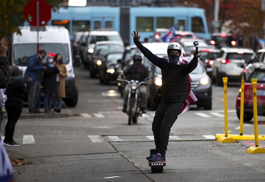 caption: An impromptu car parade and celebration took place shortly after Joe Biden was officially named the president elect on Saturday, November 7, 2020, near the intersection of 10th Avenue and East Pine Street in Seattle.