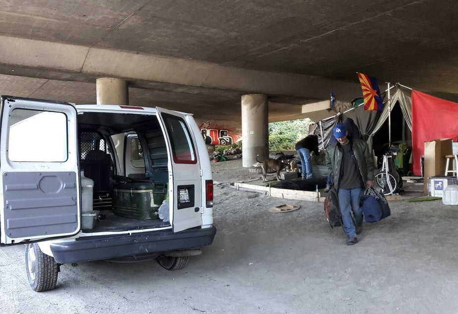 Darrel Sutton, after camping in Seattle's Jungle homeless camp for more than a year, moves with help from Union Gospel Mission workers in October 2016.