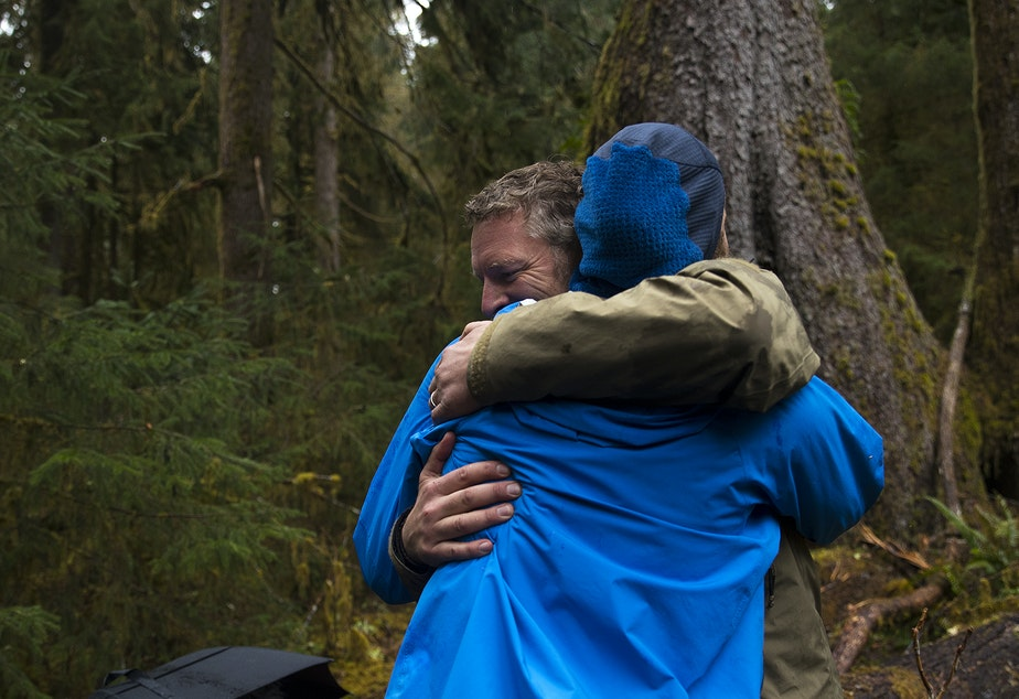 caption: Chris Morgan hugs Matt Mikkelsen after emerging from One Square Inch of Silence on Friday, April 5, 2019, in the Hoh Rainforest on the Olympic Peninsula.