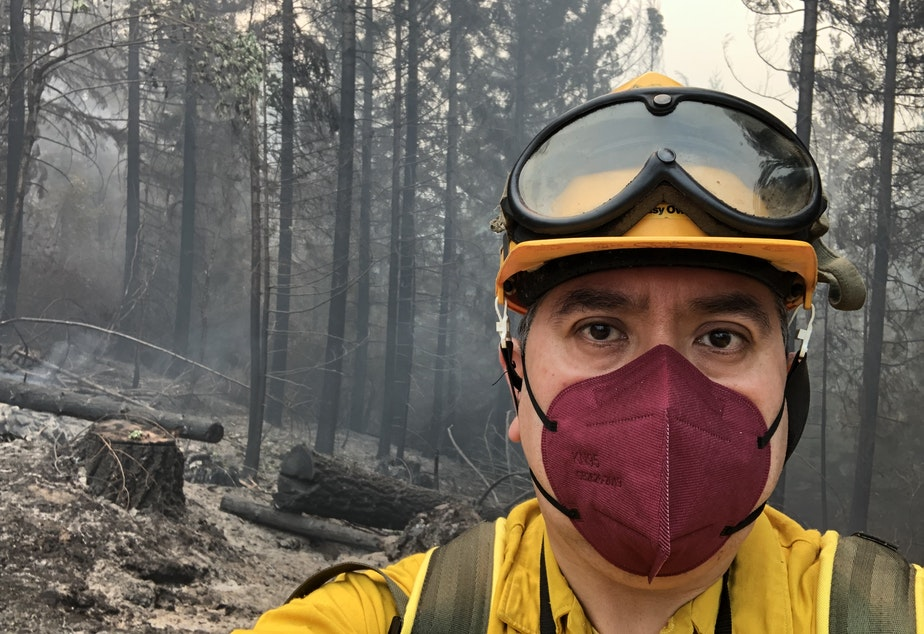 caption: KLCC reporter Brian Bull poses in full fire-safety gear at Division LL (Lima Lima) of the Middle Fork Complex in August 2021.