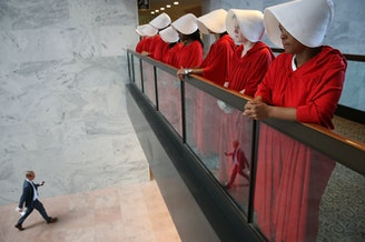 Protesters dressed as characters from <em>The Handmaid's Tale</em> outside the confirmation hearing for Brett Kavanaugh on Tuesday.