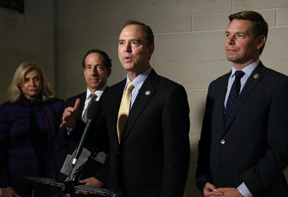 caption: Rep. Adam Schiff (center) chairs the House Intelligence Committee, which would conduct any open hearings under the House impeachment inquiry, according to procedures specified in a resolution formalizing the process.
