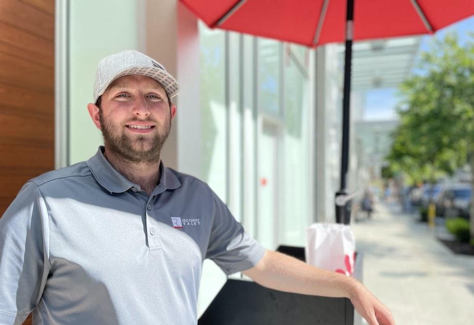 caption: Joe Sanderson is a valet just off Main Street in Bellevue.