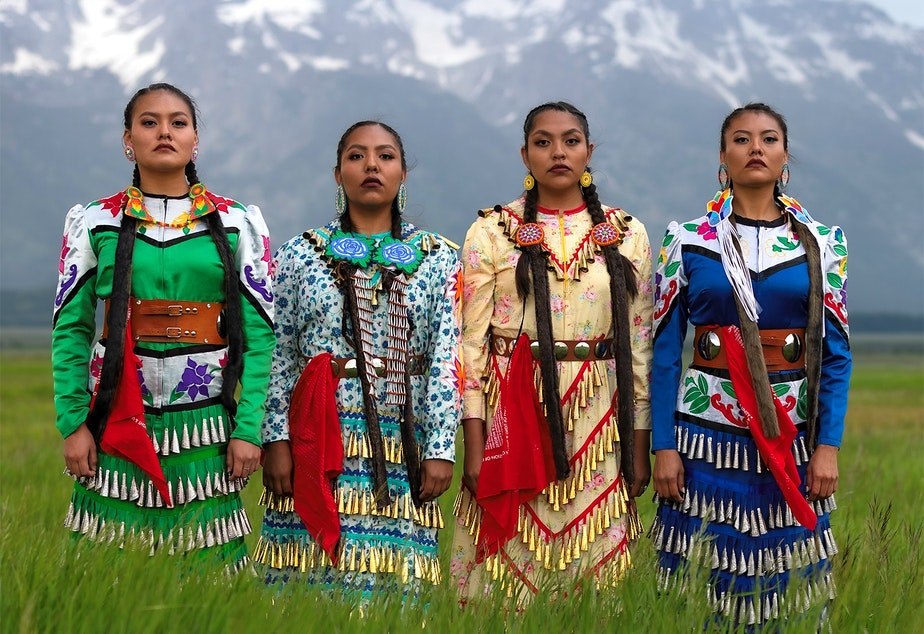 """caption: From left, JoAnni Begay, Erin Tapahe, Dion Tapahe and Sunni Begay pose for """"The Jingle Dress Project"""" creator and photographer Eugene Tapahe."""