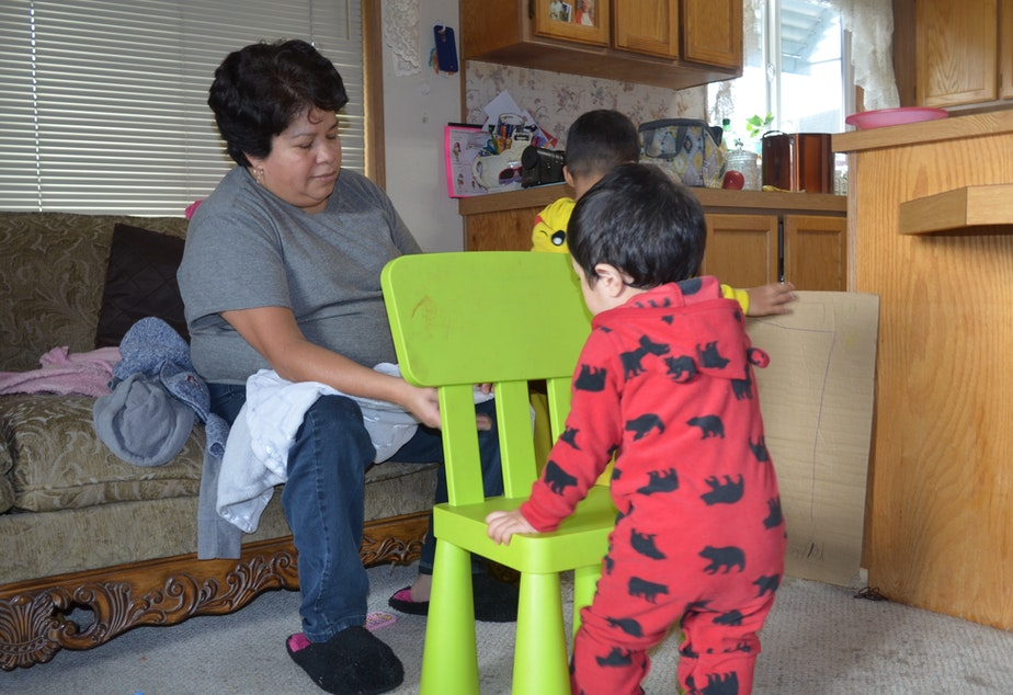 caption: Araceli Martinez cares for children in her home daycare near Tacoma. She says she learned a lot about how to reduce asthma risk for kids in her home.