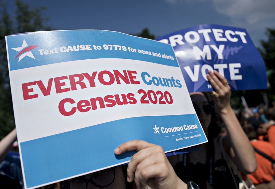 caption: A demonstrator holds a sign about the U.S. census outside the Supreme Court in Washington, D.C., in 2019. The Census Bureau has stopped all work on President Trump's directive to produce a count of unauthorized immigrants that could be subtracted from a key set of census numbers, NPR has learned.