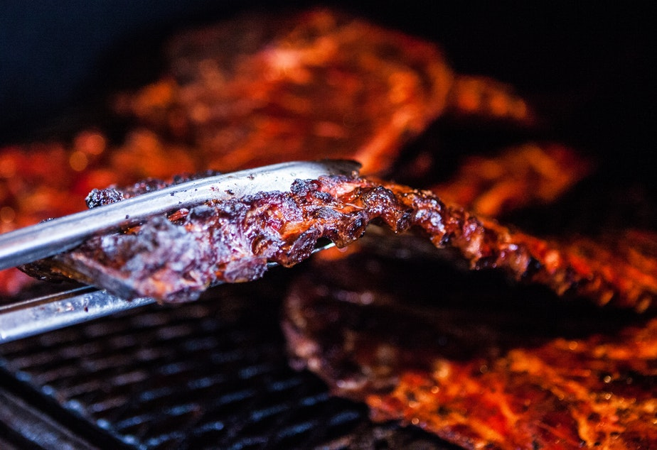 caption: Ribs cook on the barbecue pit and Real BBQ and More in Shreveport, La.