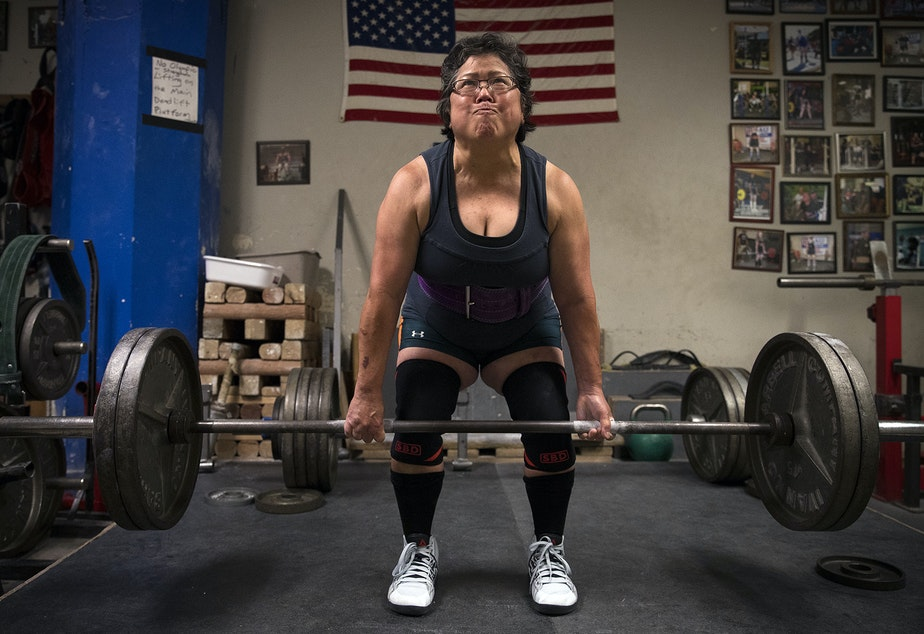 caption: Alma Kimura, 63, powerlifts at Seattle Strength and Power on 3rd Ave., in Seattle. Kimura started powerlifting at age 58.