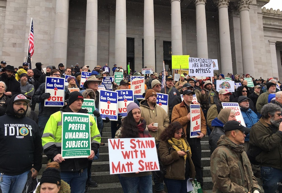 Gun rights supporters rally on the steps of the Washington state Capitol on Friday. Among the speakers was Republican state Rep. Matt Shea who participated in an act of domestic terrorism, according to a recent House investigation.