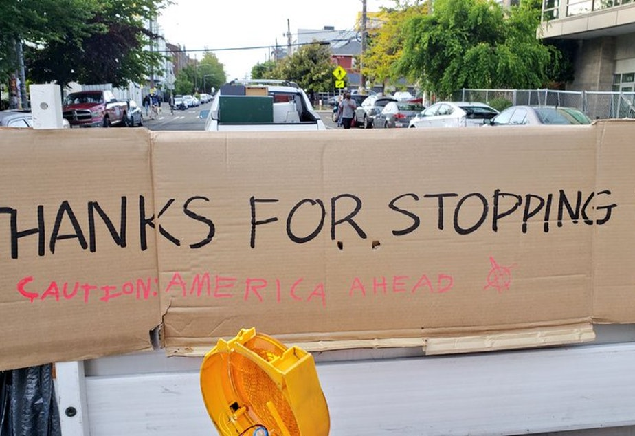 caption: A sign at the exit of Capitol Hill's occupied protest zone.