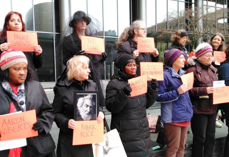 People gather Wednesday, March 8, to remember the homeless men and women who have died on Seattle's streets in the past year.