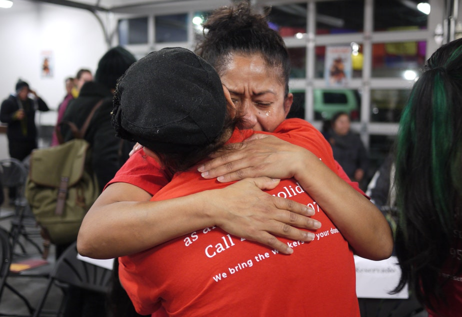 caption: Sylvia Gonzales hugs a friend after President Obama's immigration announcement