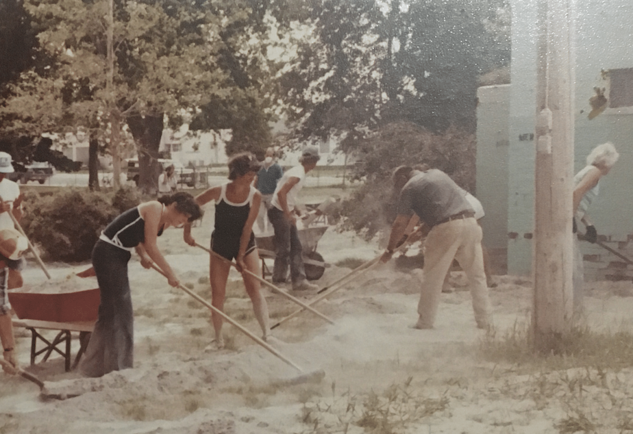 caption: Residents of Ritzville, Washington, clean up ash in the city park after Mount St. Helens erupted on May 18, 1980.