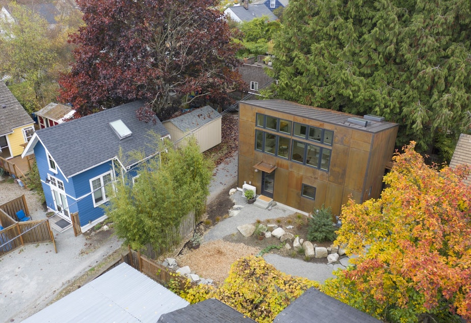 caption: Two backyard cottages on adjacent properties designed by CAST Architecture