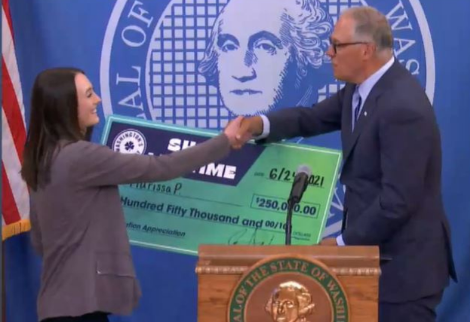 caption: Marissa P. of Spokane receives $250,000 on June 24, 2021 as part of the Shot of a Lifetime lottery, which offers prizes to Washington residents who have been vaccinated.