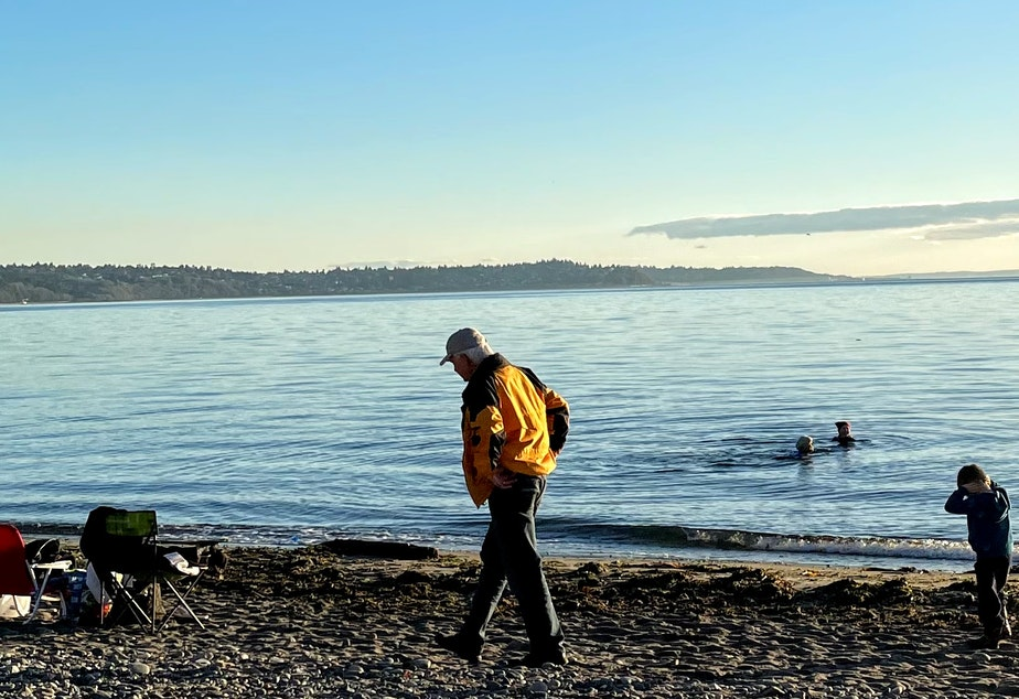 caption: In this Oct. 2020 photo, beachgoers enjoy Shoreline's Richmond Beach Saltwater Park, one of the areas closed to swimming after sewage spills in January.