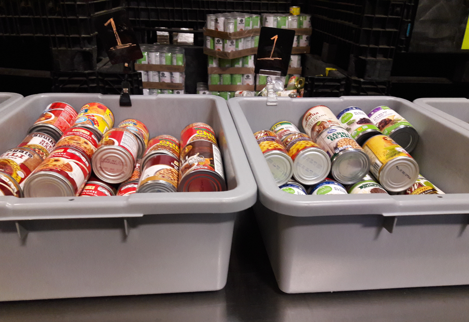 caption: Cans of food at the Ballard Food Bank.