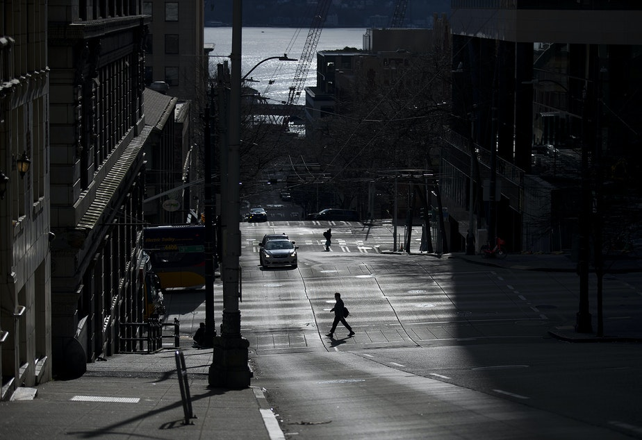 caption: A quiet downtown Seattle is shown on Wednesday, March 25, 2020, in Seattle.