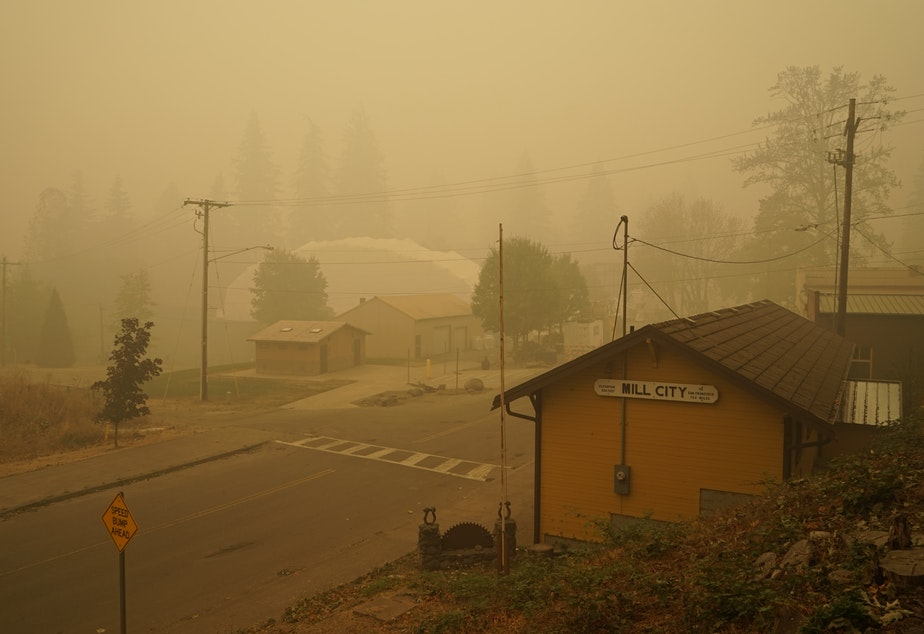 caption: Smoke blankets Mill City, Oregon, which was evacuated for days following the nearby Beachie Creek Fire.