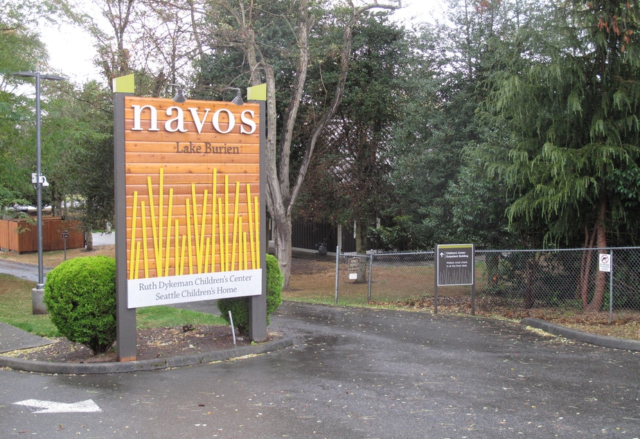 caption: Sign for Navos' Ruth Dykeman Children's Center in Burien, Wash.