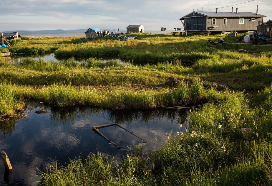 caption: Rising temperatures in Alaska are melting permafrost, widening rivers and eroding homes in the remote village of Newtok, where about a third of residents relocated to higher ground last year.