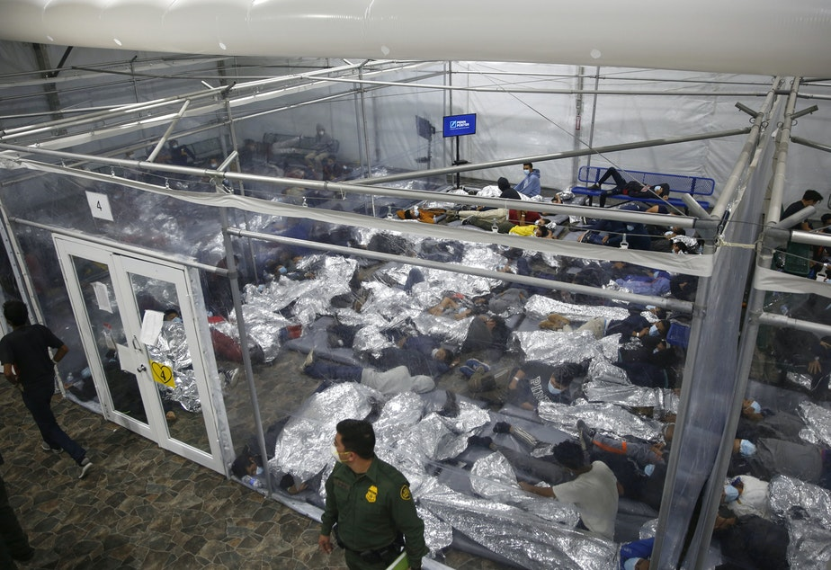 caption: The administration has struggled to house young migrants at Customs and Border Protection facilities like this one in Donna, Texas.
