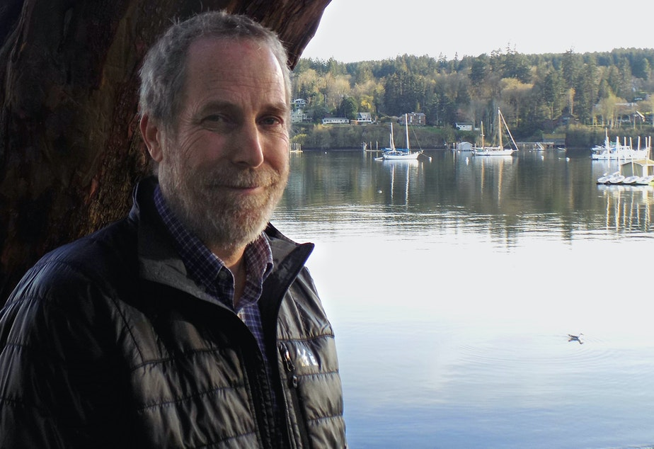 Recent retiree Michael Cox in front of Bainbridge Island's Eagle Harbor, site of an EPA toxic-waste cleanup