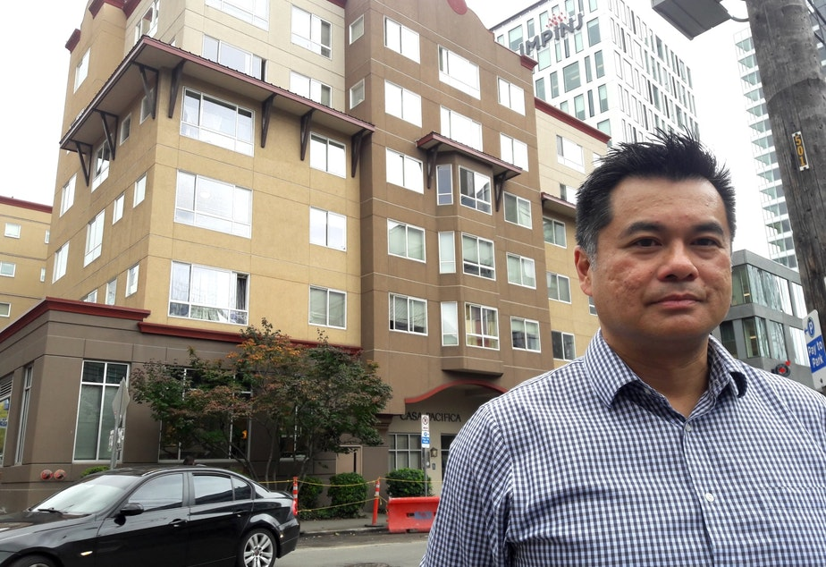Richard Loo, of Bellwether Housing, stands in front of Casa Pacifica, an affordable housing project built in South Lake Union back when land there was cheap.