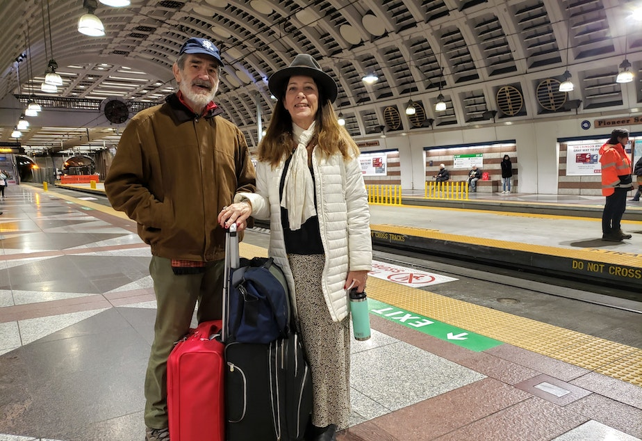 caption: Francisco and Judy Veramendi, visiting from Illinois, were worried delayed trains would mean a late arrival at SeaTac Airport on Monday, January 6th, 2020.