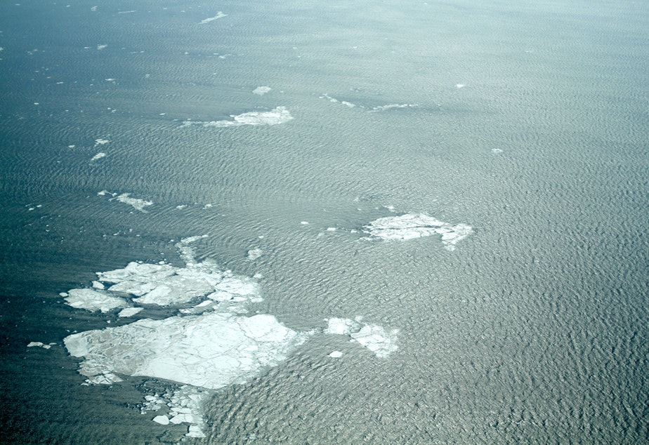 caption: A view of the sea near Kivalina, Alaska, in May 2014. Normally the ice would have been solid into June.