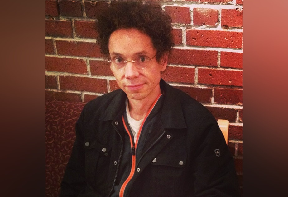 caption: Writer Malcolm Gladwell waits in KUOW's green room before an interview with The Record's Ross Reynold's.