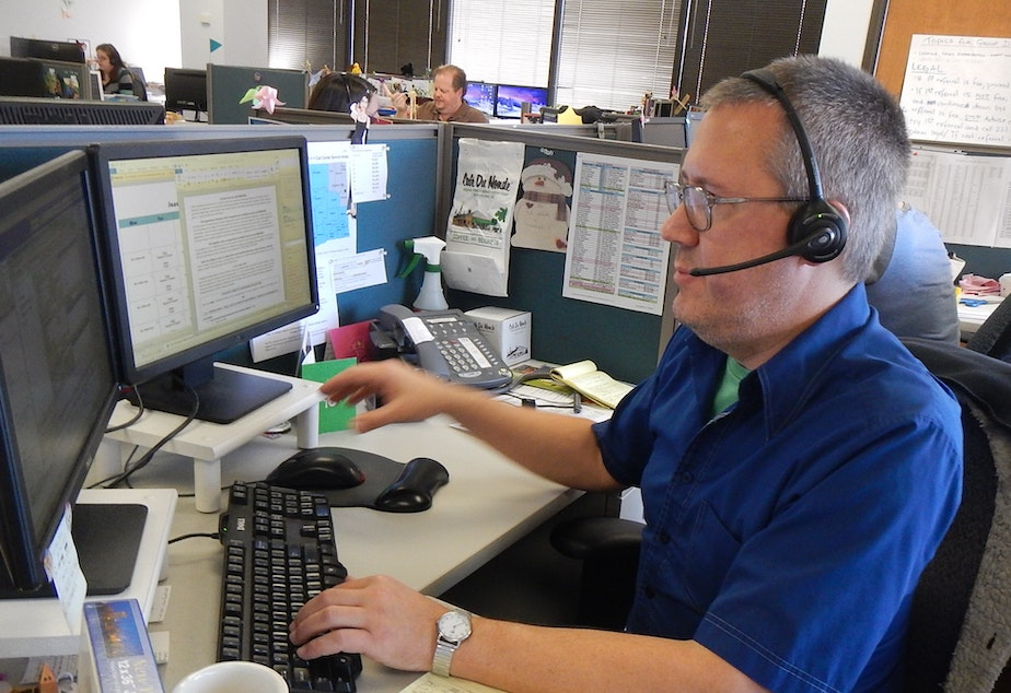 Alex Williams, an operator for 211, King County's information line for emergency food or shelter.