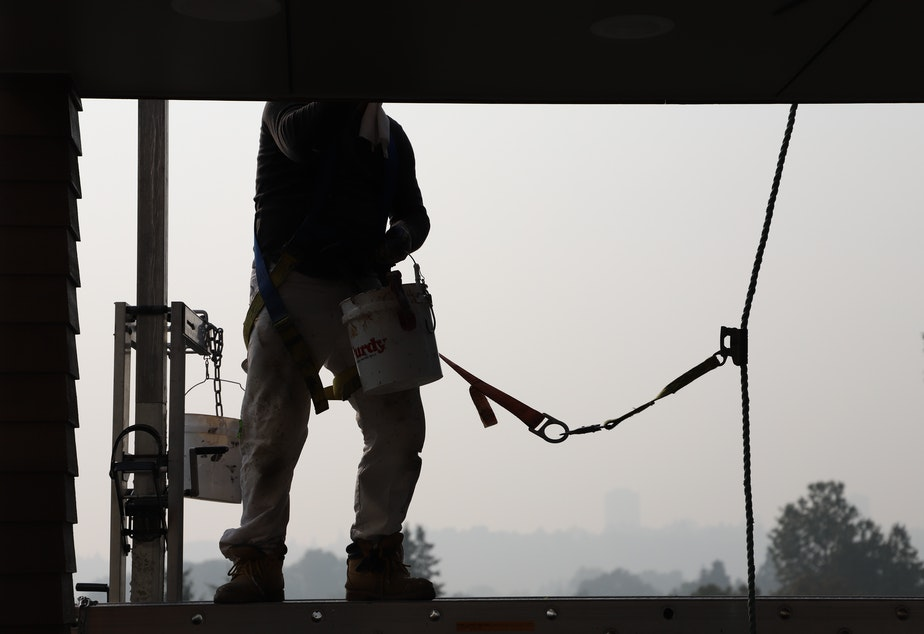 caption: Worker in Seattle September 11, 2020