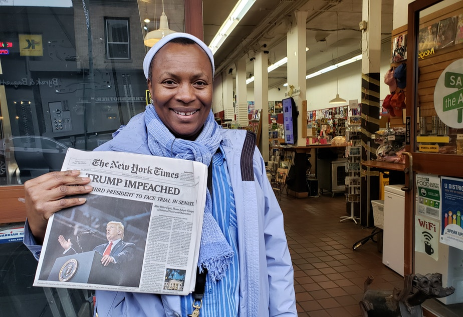 caption: Deilyn Osby Sande bought three copies of The New York Times for her family at Bulldog News on Thursday, December 19, 2019.