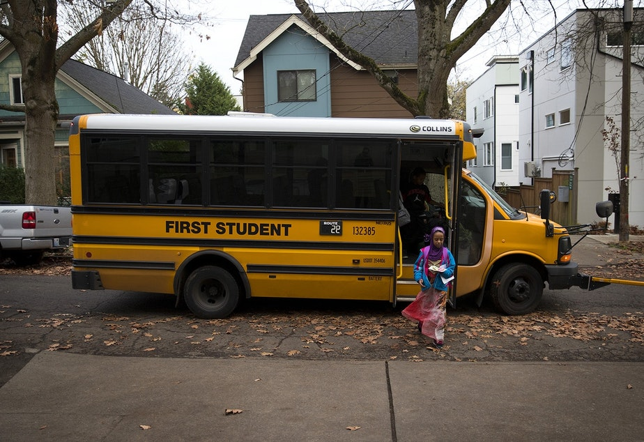 File photo: Biftu Aliya, 9, gets off of the school bus on Thursday, November 15, 2018, at her home in Seattle.