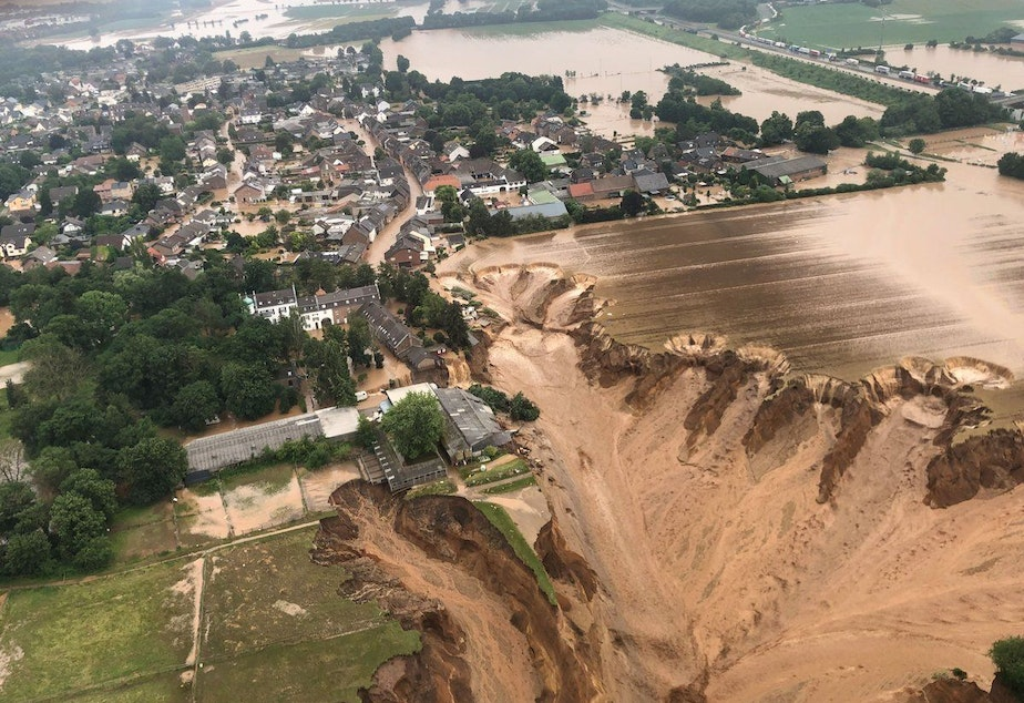 caption: Photos released by the Cologne district authority on Friday, and taken by the Rhein-Erft-Kreis district, show an entire section of a field having collapsed.