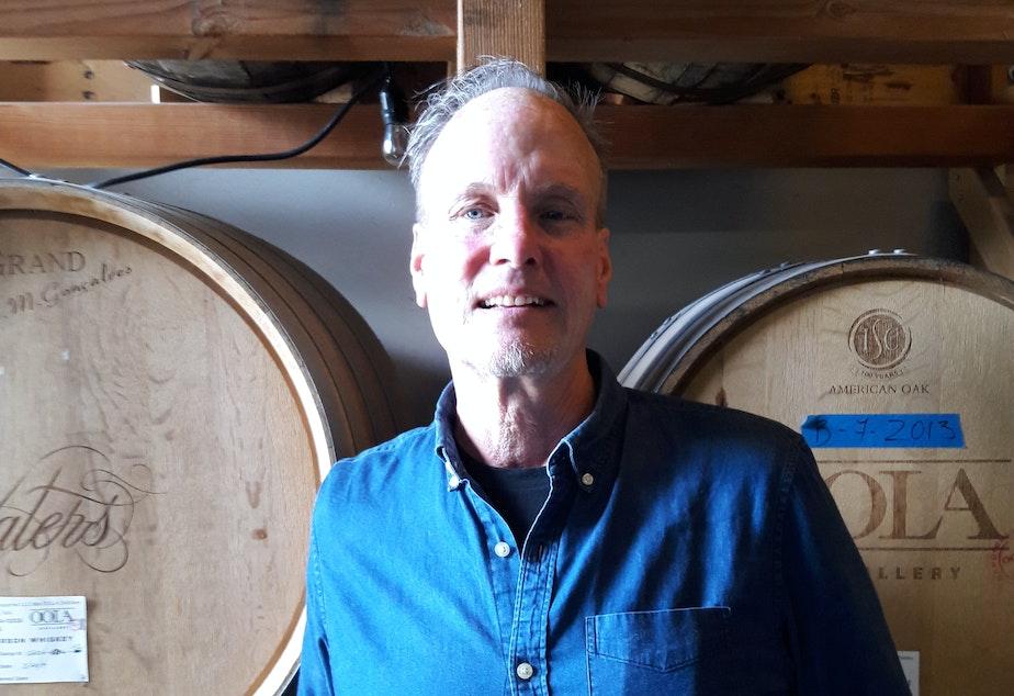 caption: Kirby Kallas-Lewis, president and head distiller at OOLA Distillery.