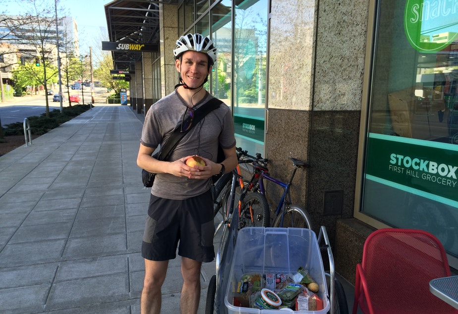 caption: Seattle Food Rescue founder Tim Jenkins picks up food from Stock Box on James St.