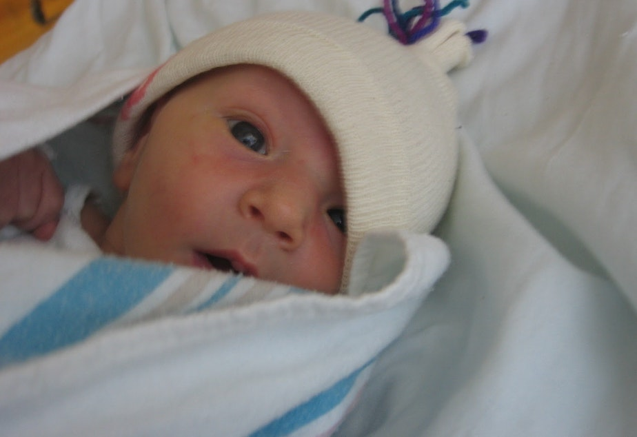 Baby Benjamin before he was placed in his adoptive mother's arms.