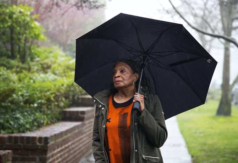 caption: Poet Colleen McElroy stands for a portrait on Wednesday, February 5, 2020, outside of the Queen Anne Library in Seattle.