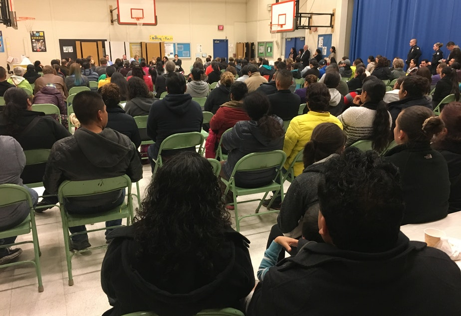 caption: Immigrants packed a gym in Bellevue on Thursday night to talk about Trump's immigration plan.