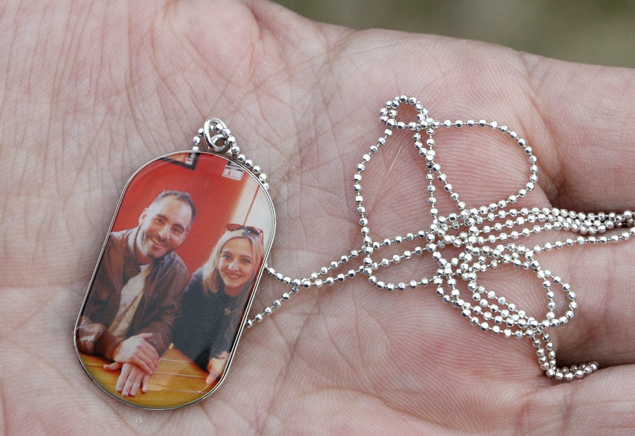 caption: Aya Al-Umari, whose brother Hussein Al-Umari was killed in the Al Noor mosque shooting, holds a pendant with a photo of herself and Hussein during an interview at her home in Christchurch, New Zealand.