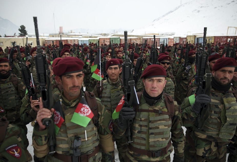 caption: Afghan Army commandos attend their graduation ceremony after a 3 1/2-month training program, at the Commando Training Center on the outskirts of Kabul, Afghanistan, on Monday.