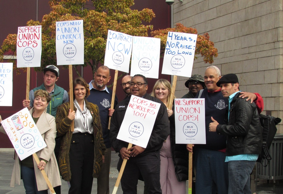 caption: The MLK County Labor Council called on the Seattle City Council to pass the SPOG contract in 2018. Sawant voted against it.