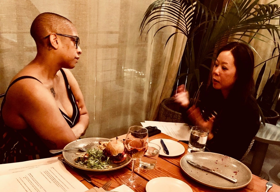 caption: KUOW Curiosity Club members Sharlese Metcalf (left) and Shin Yu Pai talk at The Cloud Room during the Club's first dinner on January 19, 2019.