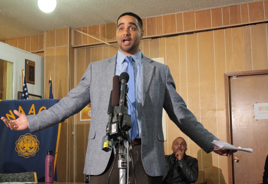 caption: Garfield Teacher Jesse Hagopian says rising standards plus inadequate education funding means minorities lose. Behind him sits Gerald Hankerson of the Seattle King County NAACP. Hankerson's comments suggested his group will consider a lawsuit.