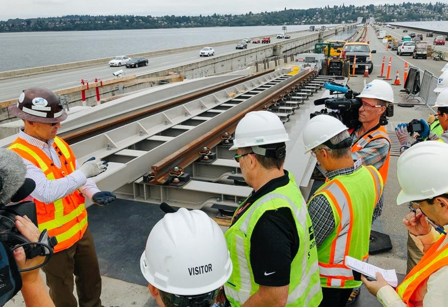 Sound Transit's John Sleavin explains to Seattle media outlets how rails will be installed across the I-90 floating bridge