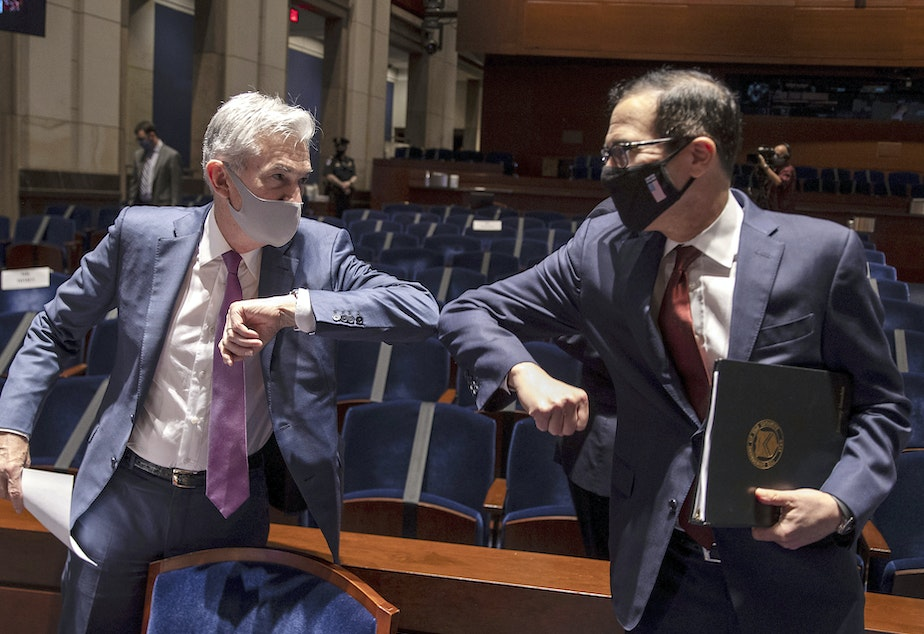 caption: Fed Chairman Jerome Powell and Treasury Secretary Steven Mnuchin bump elbows at the conclusion of their testimony before Congress on June 30, 2020. The Fed and Treasury are engaging in a rare clash over the fate of key pandemic lending programs.